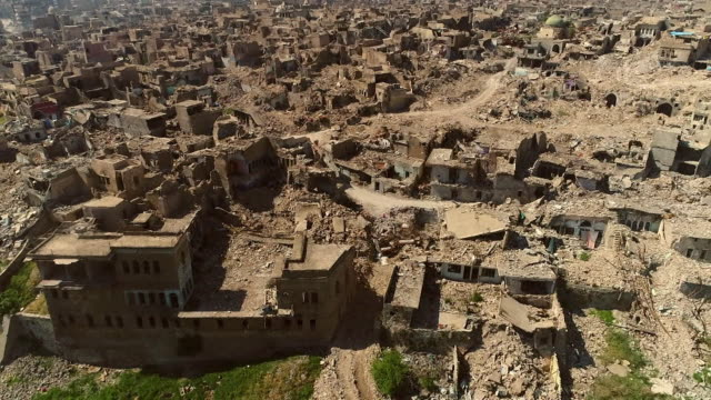 aerial view of houses destroyed by air strikes in mosul, iraq - イラク点の映像素材/bロール