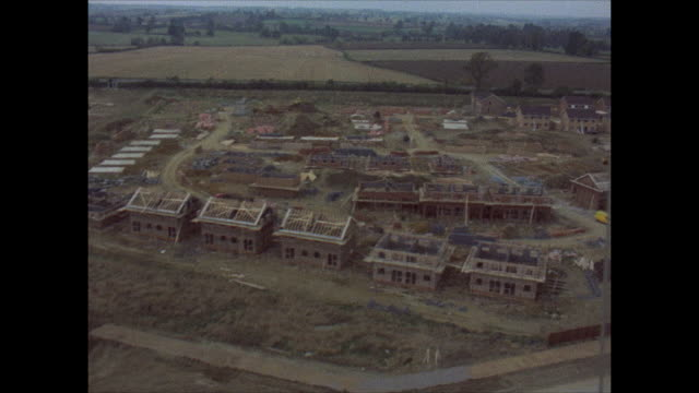 aerial view of houses in new residential neighborhoods being built. - construction industry stock videos & royalty-free footage