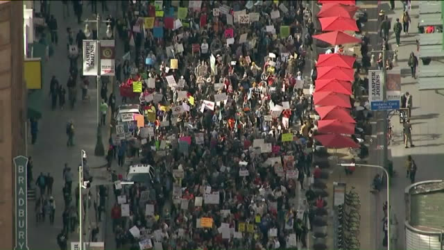 aerial view of hundreds of thousands rallying for gun control in march for our lives on march 24 2018 in los angeles ca united states - march for our lives video stock e b–roll