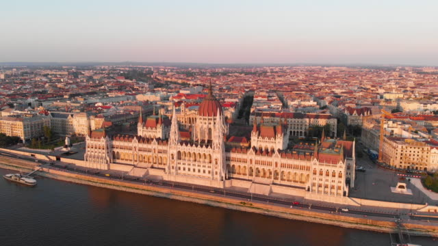 aerial view of hungarian parliament at golden hour - river danube video stock e b–roll