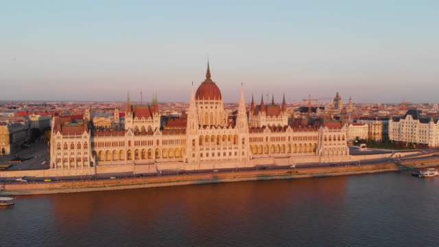 aerial view of hungarian parliament at golden hour - budapest video stock e b–roll