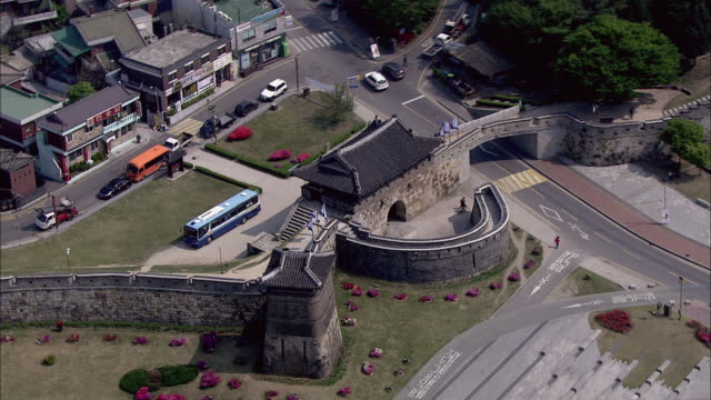aerial view of hwaseomun gate at suwon hwaseong (unesco world heritage) - suwon stock videos and b-roll footage