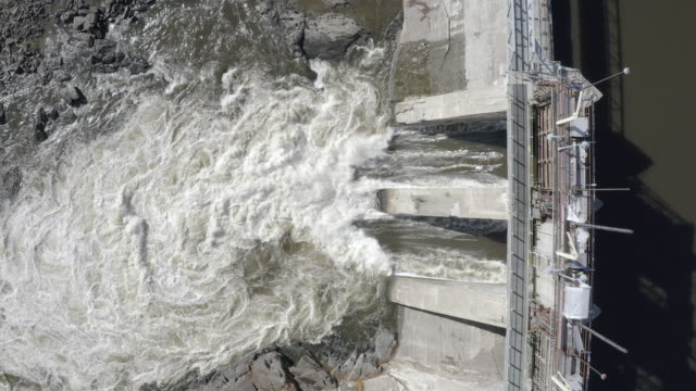 aerial view of hydro electricity dam - falling water stock videos & royalty-free footage