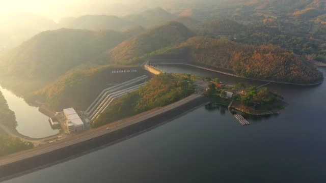 aerial view of hydro power electric dam in thailand, the large dam to generate electricity,large electric power dam in valley of western thailand.srinagarind dam in sunrise at kanchanaburi province thailand. - sustainable tourism stock videos & royalty-free footage