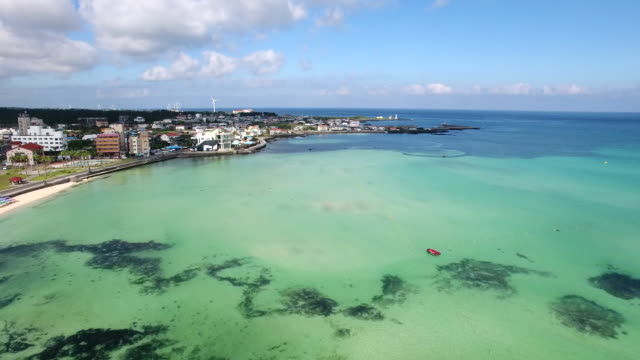 stockvideo's en b-roll-footage met aerial view of hyeopjae beach and coastal feature in jeju island - coastal feature