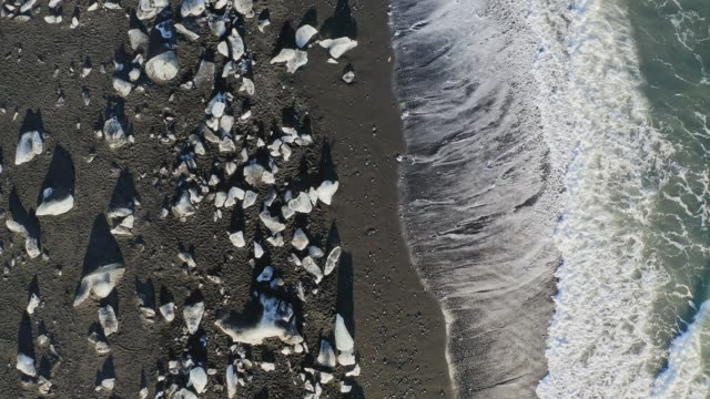 aerial view of ice on diamond beach, iceland - ice sheet stock videos & royalty-free footage
