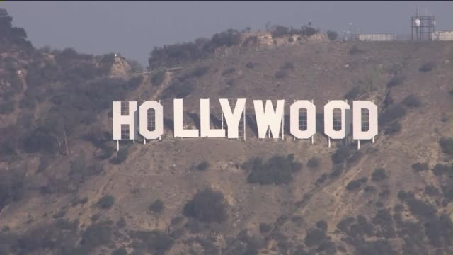 aerial view of iconic hollywood sign. - hollywood california stock videos & royalty-free footage