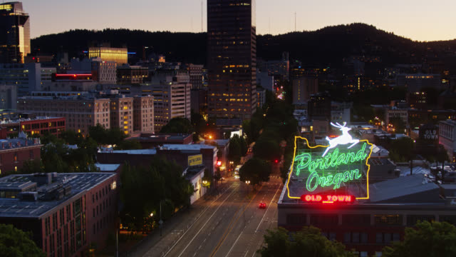 aerial view of iconic white stag sign of portland, oregon - portland oregon stock videos & royalty-free footage