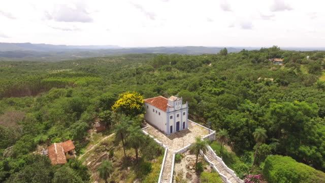 aerial view of igreja de nossa senhora aparecida - areias, town of goiás - cidade stock videos & royalty-free footage
