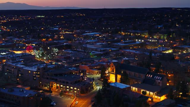 aerial view of illuminated downtown santa fe, new mexico at night - establishing shot stock videos & royalty-free footage