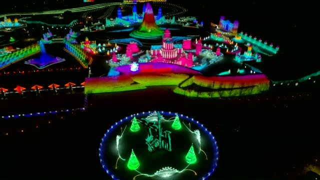 aerial view of illuminated ice sculptures during the 36th harbin international ice and snow festival at the harbin ice and snow world on january 6... - snow festival stock videos & royalty-free footage