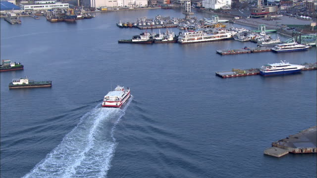 aerial view of incheon port with passing tourboat - tourboat stock videos and b-roll footage