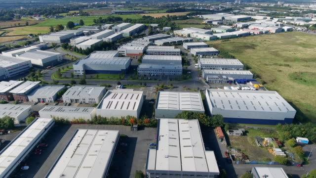 aerial view of industrial buildings in a business park - officina video stock e b–roll