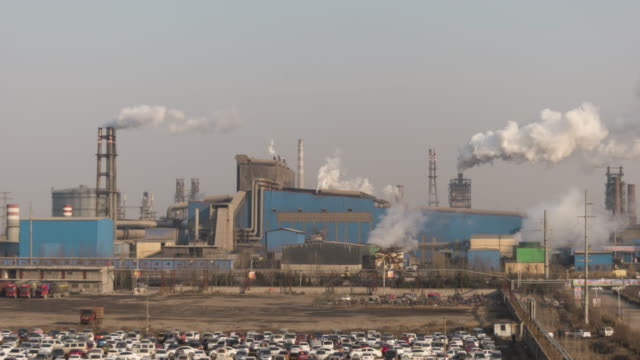 t/l ms ha tu aerial view of industrial district with smokestacks / shandong, china - carbon footprint stock videos and b-roll footage
