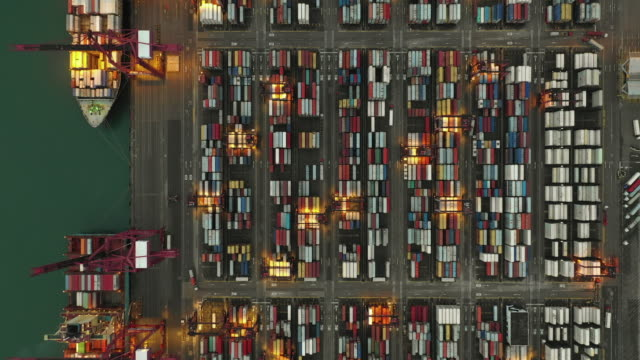aerial view of industrial port with containers ship in hong kong stock - inquadratura da un aereo video stock e b–roll
