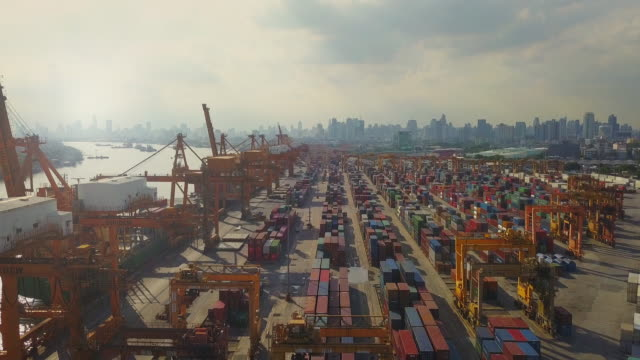 aerial view of industrial port with containers ship - unloading stock videos & royalty-free footage