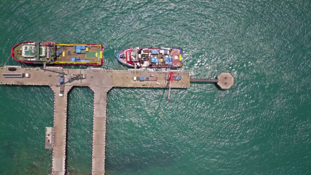 aerial view of industrial port with containers ship - pier stock videos & royalty-free footage