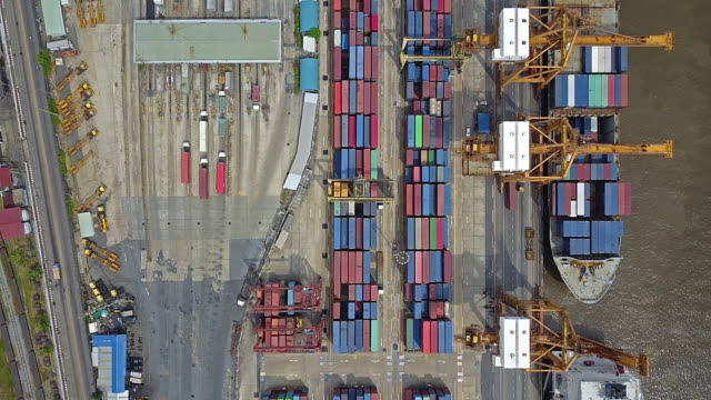 aerial view of industrial port with containers ship - costa caratteristica costiera video stock e b–roll