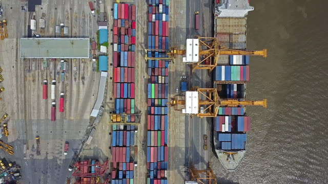 aerial view of industrial port with containers ship - coastline stock videos & royalty-free footage