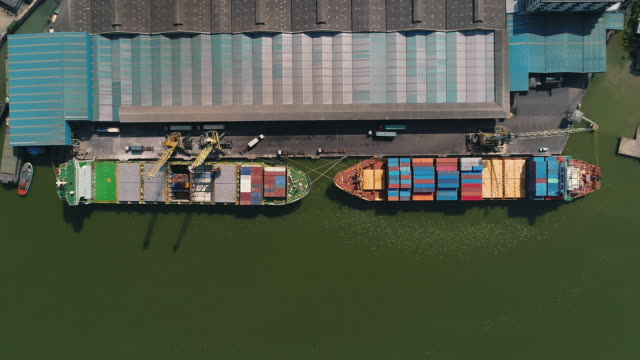 aerial view of industrial port with containers ship - station stock videos & royalty-free footage
