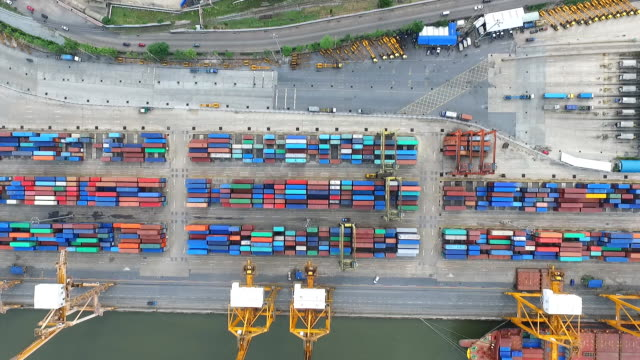 aerial view of industrial port with containers ship - overhead projector stock videos & royalty-free footage