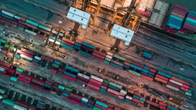 aerial view of industrial port with containers ship,time lapse - mezzo di trasporto video stock e b–roll