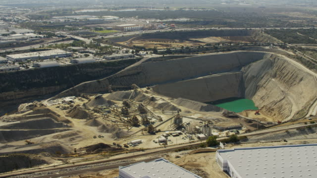 aerial view of industrial quarry los angeles california - construction vehicle stock videos & royalty-free footage