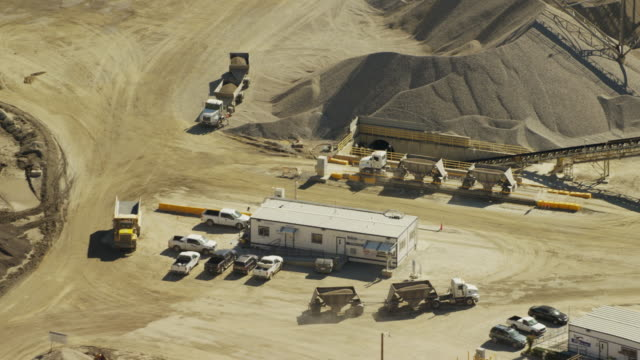 aerial view of industrial quarry los angeles hills - construction vehicle stock videos & royalty-free footage