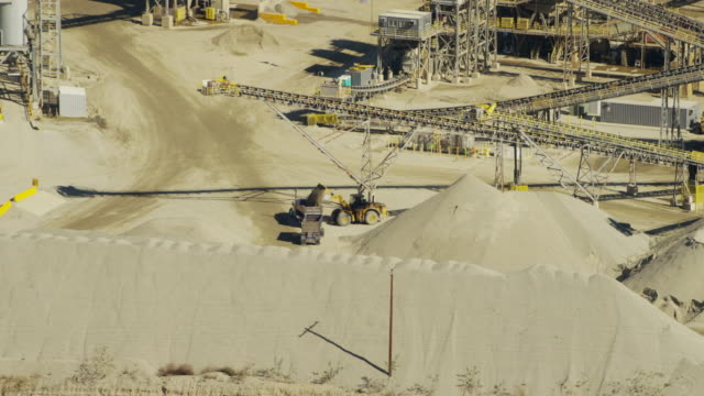 aerial view of industrial quarry los angeles hills - crane construction machinery stock videos & royalty-free footage