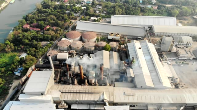 Aerial view of Industry factory manufacturing with emission smoke from chimneys into the sky