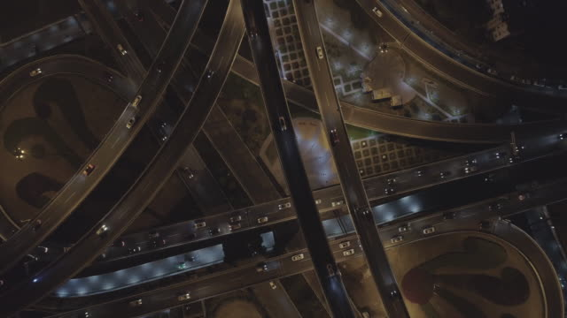 aerial view of interchange overpass and traffic flow - zoom out stock videos & royalty-free footage