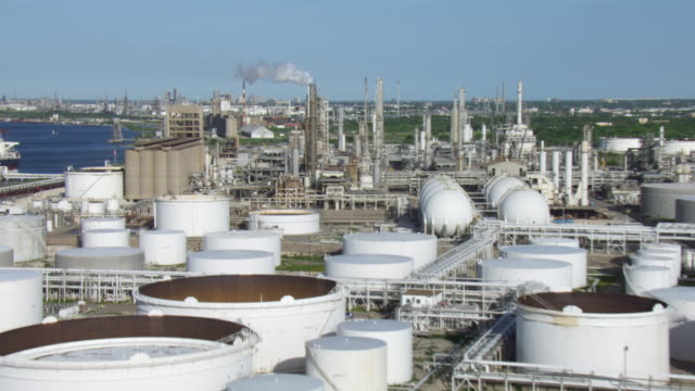 stockvideo's en b-roll-footage met aerial view of interstate grain corporation with oil and gas industrial plant in corpus christi, texas, united states of america. - bay of water