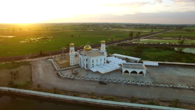 aerial view of islamic mosque on sunset - monument stock videos & royalty-free footage