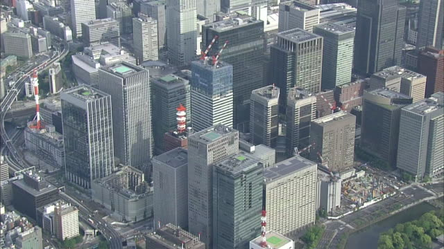 aerial view of japan's economic center around tokyo station - aircraft point of view stock videos & royalty-free footage