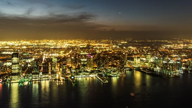 T/L Aerial View of Jersey City and the Hudson River at Night