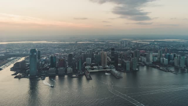 T/L PAN Aerial View of Jersey City and the Hudson River at Sunset