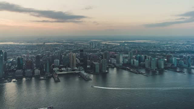 T/L PAN Aerial View of Jersey City Skyline at Sunset