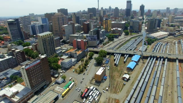 stockvideo's en b-roll-footage met aerial view of johannesburg cbd and trains, johannesburg, south africa - johannesburg