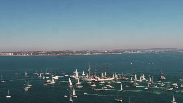 aerial view of juan sebastián elcano on february 12, 2018 algeciras, spain. sebastián elcano is a training ship of the spanish navy. it is named... - small boat stock videos & royalty-free footage