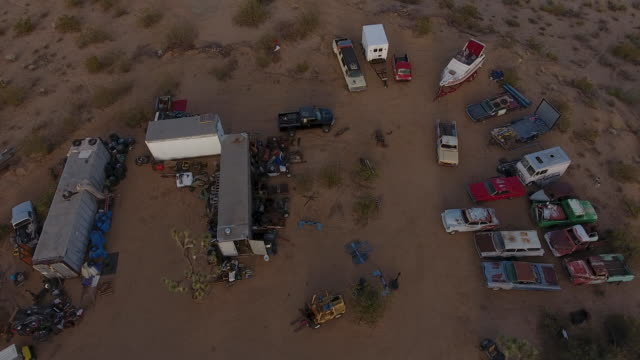 aerial view of junk yard in palm springs - abandoned stock videos & royalty-free footage