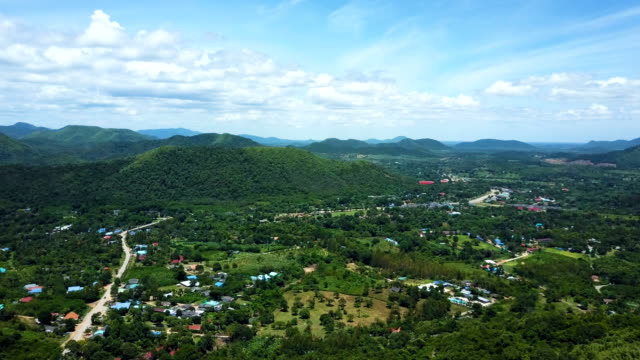 aerial view of kaeng krachan national park dam surrounded by green vegetation and nature. concept of:  adventure, travel and holidays. - motorway junction stock videos & royalty-free footage