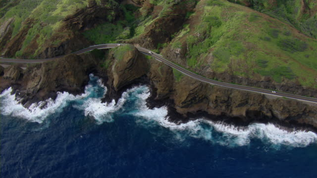 aerial view of kalanianaole highway on the rugged eastern coast of oahu near koko crater. - oahu stock videos and b-roll footage