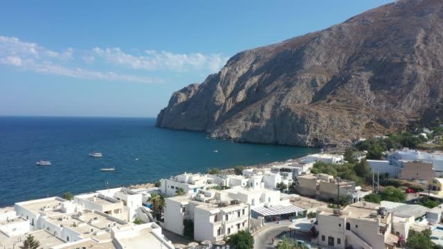 aerial view of kamari beach in santorini, greece - santorini stock videos and b-roll footage
