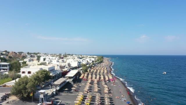 aerial view of kamari beach in santorini, greece - santorini stock videos & royalty-free footage