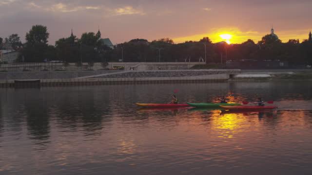 aerial view of kayaking friends. vistula river during sunset - warsaw stock videos & royalty-free footage