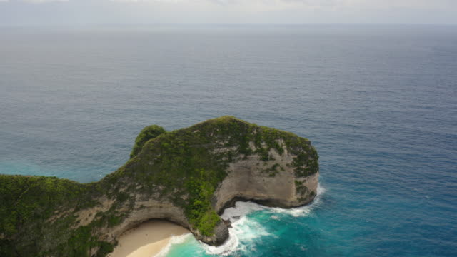 aerial view of kelingking beach, nusa penida, indonesia - island stock videos & royalty-free footage