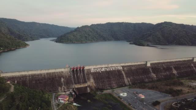 aerial view of khun dan prakan chol dam in thailand - hydroelectric power stock videos and b-roll footage