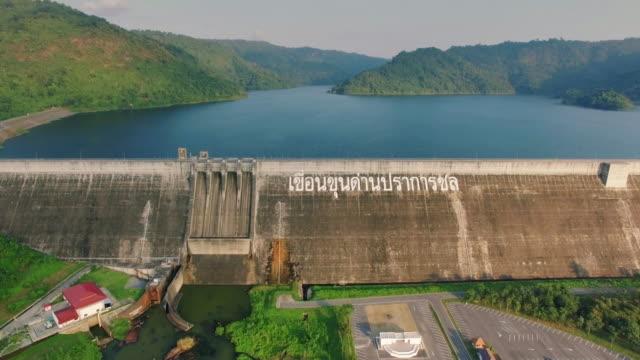 aerial view of khun dan prakan chol dam, thailand - hydroelectric power stock videos and b-roll footage