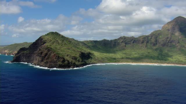Aerial view of Kipu Kai cove and beach with mountains on the Hawaiian Island of Kauai.