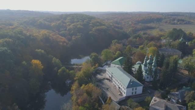 Aerial view of Kitaevo monastery in Kiev. Autumn leaf colors